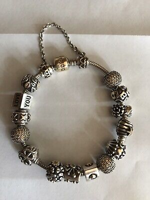 Pandora Bracelet With 14 Sterling Silver and 14kt Charms 14 KT Gold clasp 7.5""