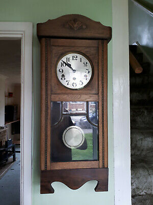antique wall clock in need of repair