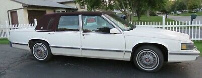 1991 Cadillac DeVille -- 1991 CADILLAC DeVILLE WHITE EXTERIOR W/ REAR BURGUNDY CLOTH TOP COLLECTORS ITEM