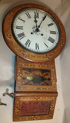 Antique wooden wall clock with pattern (works) 30 inches tall