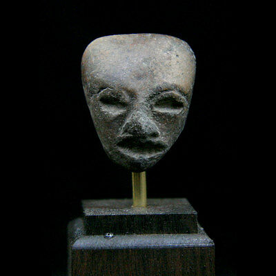 A Pre-Colombian Teotihuacan clay figurative fragment: 200 - 800 A.D.  y2635