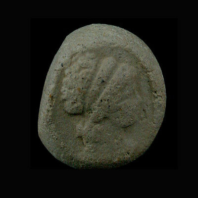 A Phoenician clay bulla the image depicting a ladies head in profile. e8106