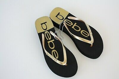 0fbf87bfba3a Bebe Womens Black Gold Crystal Rhinestone Logo Wedge Flip Flops Sandals Sz 7