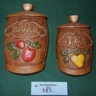 2 Vintage 1967 Sexton Metal Kitchen Wall Plaques SUGAR and TEA Canisters