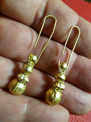 Ancient gold, antique earrings.Golden find   Metal detector finds 100% original