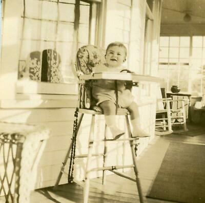 AB505 Vtg Photo BABY IN WOODEN HIGH CHAIR ON PORCH c Early 1900's