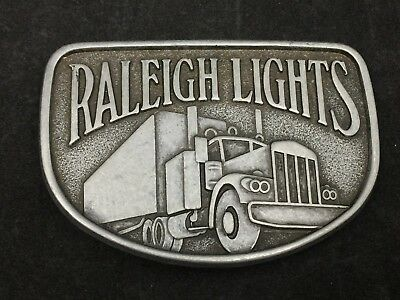VINTAGE METAL BELT BUCKLE RALEIGH LIGHTS CIGARETTES SEMI-TRUCK-2 x 3.25 INCHES