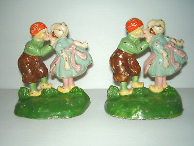 "ANTIQUE ""HUBLEY"" Pair Cast Iron Dutch Boy and Girl Kissing Doorstops/Bookends"