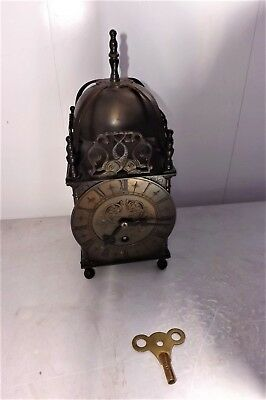 Lantern clock  mechanical movement in good working order comes with key.