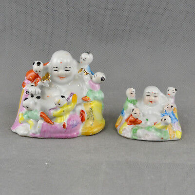2 Chinese Porcelain figurines of Laughing Buddha with 5 Children