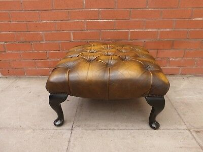 A Tanny Brown Leather Chesterfield Queen Ann Foot Stool