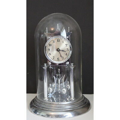 A 1920's Chrome Cased Anniversary Clock under Glass Dome 400 Day