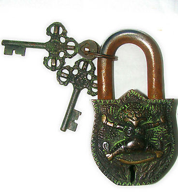 An Unusual wonderful  Brass CHINESE DEMON FIGURE PADLOCK with 2 keys from India