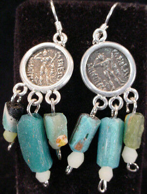 A pair of earrings with central Bactrian empire silver coated copper coin. e3972
