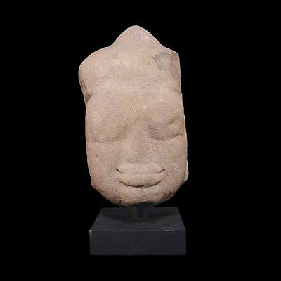 A Khmer sandstone head of a temple deity or heavenly being. 09237