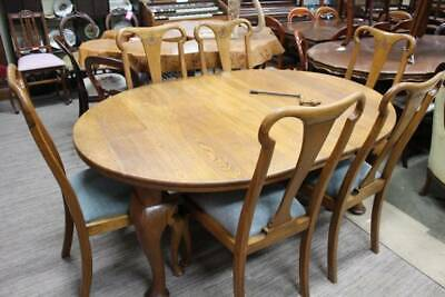 A Restored Antique Oak 7 Piece Extension Dining Setting