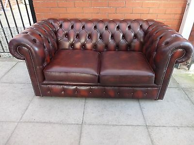 A Reddy/Brown Leather Chesterfield Two Seater Settee ***DELIVERY AVAILABLE**