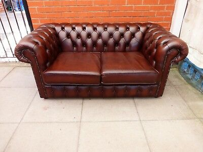 A Dark Brown Leather Chesterfield Two Seater Settee ***DELIVERY AVAILABLE**