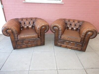 A Pair Of Antique Large Tanny Brown Leather Chesterfield Club/Armchairs
