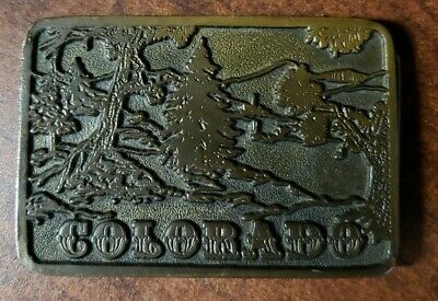 COLORADO BRASS TONE BELT BUCKLE by Adezy, Denver Copyright 1975 (Forest Scene)