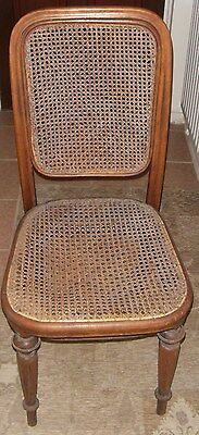 Antique wicker/rattan chair with wooden legs