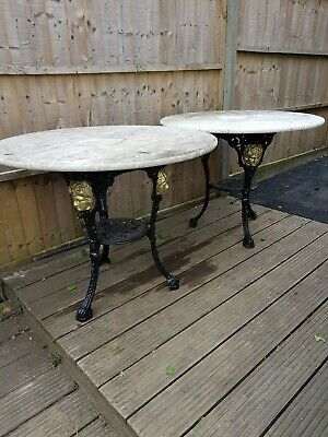 Cast iron pub tables with marble tops
