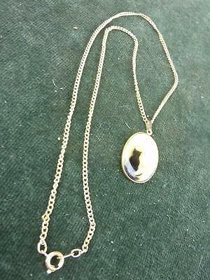 Vintage oval mother of pearl effect pendant with a cat silhouette chain necklace