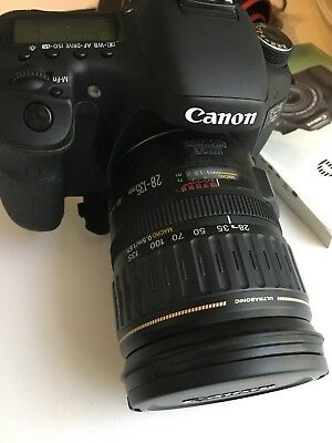 Canon EOS 7D DC 8.1V Digital SLR Camera with Lens EF 28-135mm ultrasonic Black