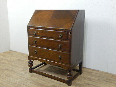 Antique oak bulbous bureau cabinet with three drawers and pull down writing desk