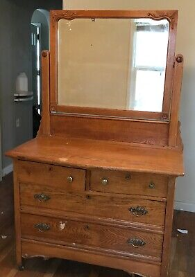 antique white oak dresser with attached mirror. 2 lg drawers; 2 small drawers