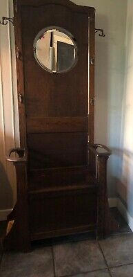 Antique oak hall stand with coat hooks, umbrella holder and mirror