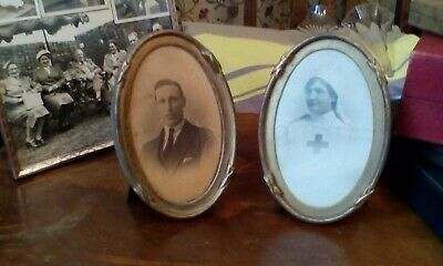 Two Edwardian or later brass and wood photo frames