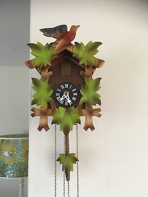 Black Forest German Carved Wooden Cuckoo Clock. Working Great Condition.