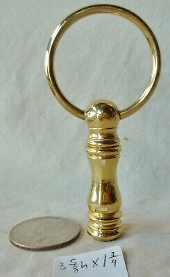 "Lamp Finial  VINTAGE 3 5/8""h  x 1 3/4""across loop solid brass"