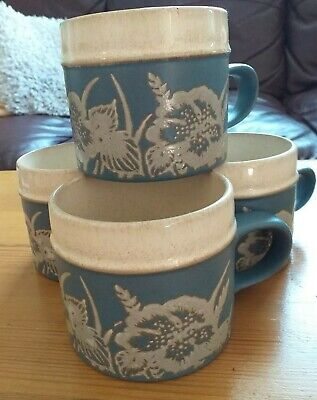 4 x Denby partially Glazed leaf and flower embossed Stoneware mugs blue/cream.