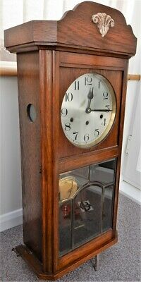 Antique Wall Clock in oak. 8-day movement with Westminster chime