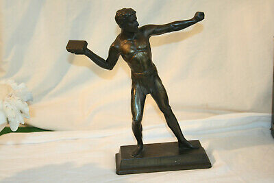 Spelter figure of male athlete throwing block