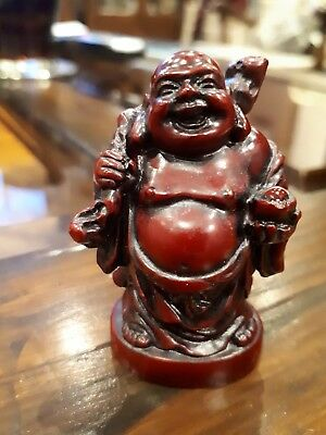 "Red resin miniature Buddha laughing happy travelling style knapsack, 2"" high."