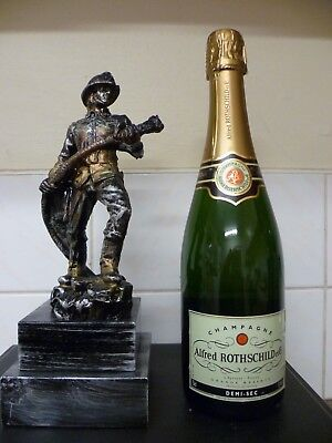 A Large / Heavy Cast Figurine Of A French 'Sapeur Pompiere' Firefighter Figurine
