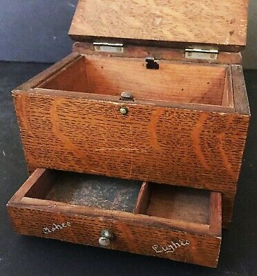 An early 20thC oak cigar cigarette and tobacco box.