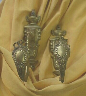 Pair of antique French solid bronze curtain tie backs, bow crested medallions