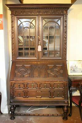 A Stunning Jacobean Decoratively Carved Oak Glazed Bookcase Bureau Desk