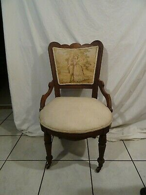 Antique Victorian Wood Carved Chair original Wood Wheels Couple Strolling
