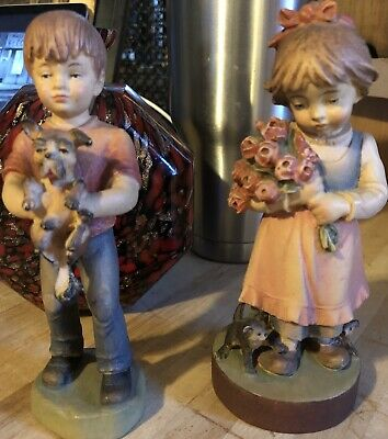 A Pair Of Wooden Carvings A Boy And Girl W/Pets