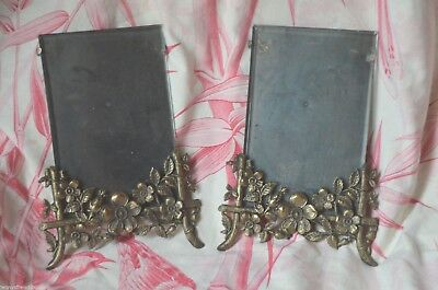 Pair of antique French bronze coated photograph holders, ornate floral base