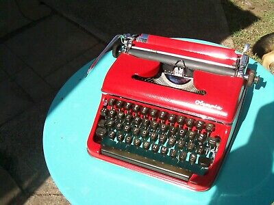 Beautiful old Olympia portable typewriter and case