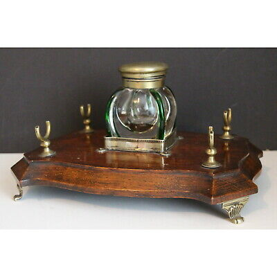 An Edwardian Oak Desk Stand, with Powell Glass Inkwell