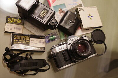 MINT- CANON AE-1 w/ FD 50mm f/1.8 lens, flash, more / NEW LIGHT SEALS