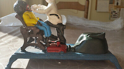 The Dentist Chair mechanical bank - Reproduced from Original in Collection of Th
