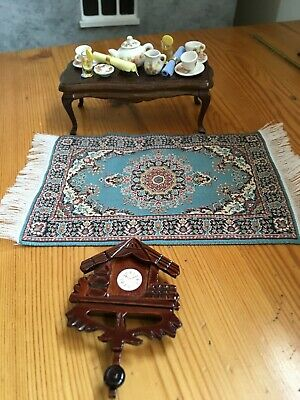Dolls house miniatures. Occasional table set for tea, wall clock and rug. 1/12
